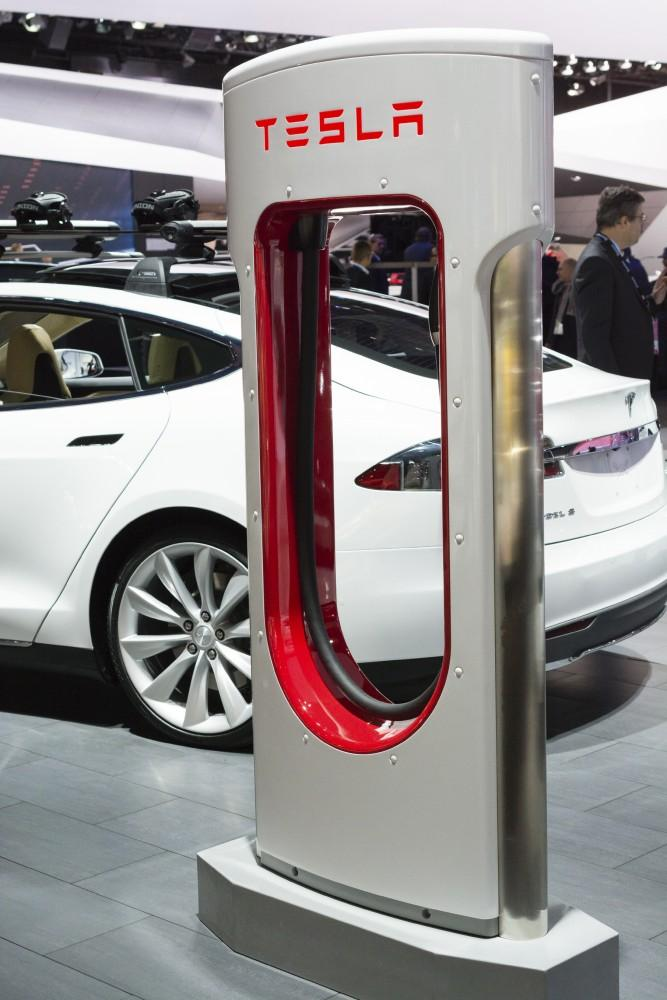 Detroit, MI, USA - January 12, 2015: Tesla Model S and charging station on display during the 2015 Detroit International Auto Show at the COBO Center in downtown Detroit.