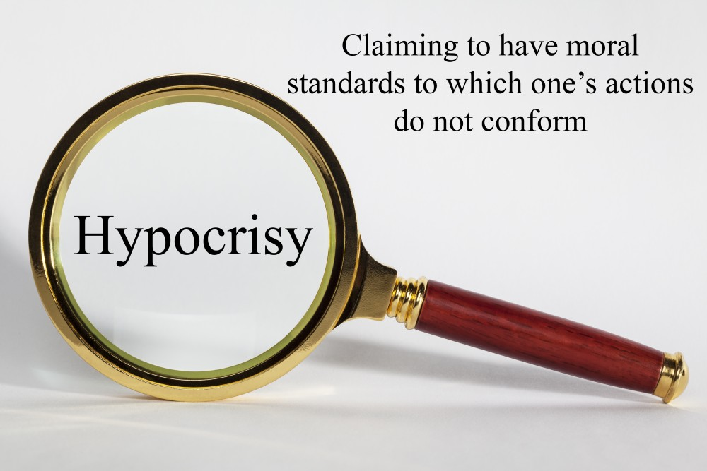 Hypocrisy Concept - looking at hypocrisy through a magnifying glass, and definition.