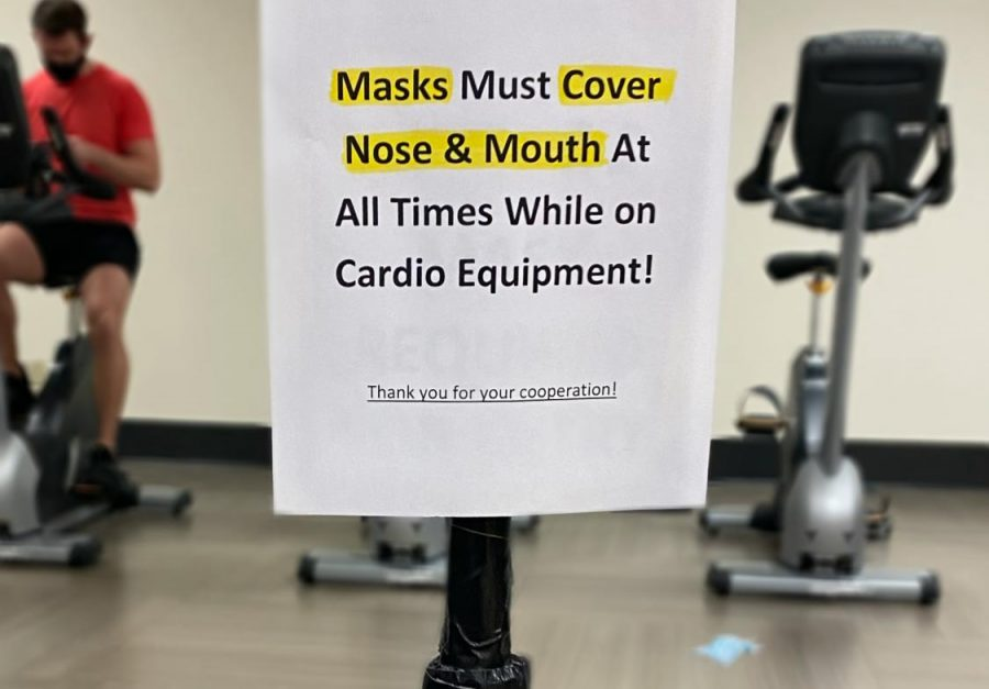 "Current COVID-19 procedures are making it difficult for local gyms to not only stay open, but stay on top of reluctant anti-mask patrons. Once a place of gathering, now a place of robotic, socially distant, nervous energy. As staff desperately try to keep patrons in line, discarded masks and advisory signs now litter gym floors. Gym member Ming Dao says, ""I would use the cardio equipment if I did not have to wear a mask, I hate it. Nobody uses the treadmills anymore so they won't faint. I am tired of having staff remind me."""