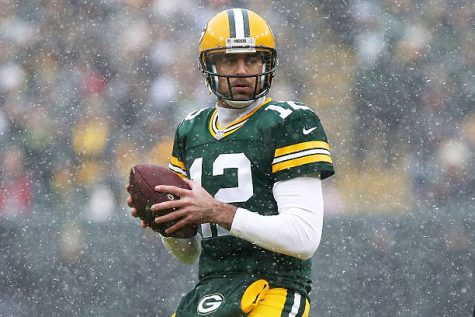 GREEN BAY, WI - DECEMBER 04:  Aaron Rodgers #12 of the Green Bay Packers drops back to pass in the first quarter against the Houston Texans at Lambeau Field on December 4, 2016 in Green Bay, Wisconsin. (Photo by Dylan Buell/Getty Images)